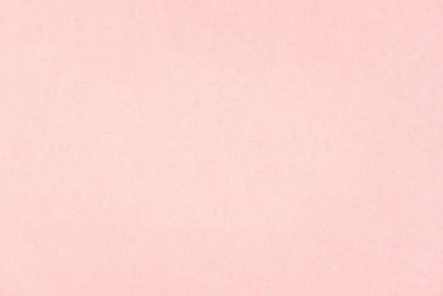 クラフトペーパーピンクまたはローズゴールドのテクスチャ。バレンタインデーの背景
