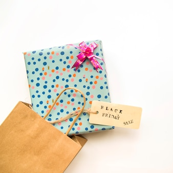 Craft shopping bag with present box and sale tag