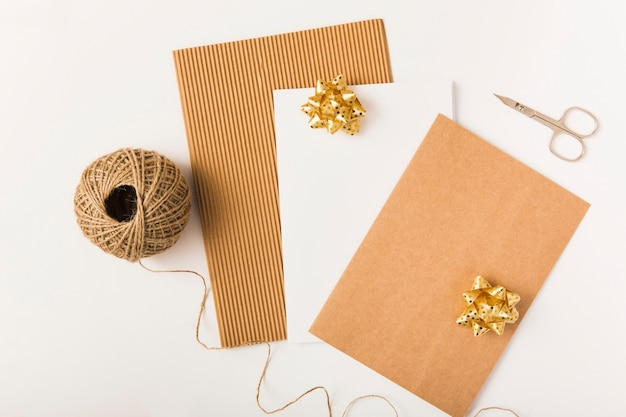 Craft wrapping paper with golden bows on white background