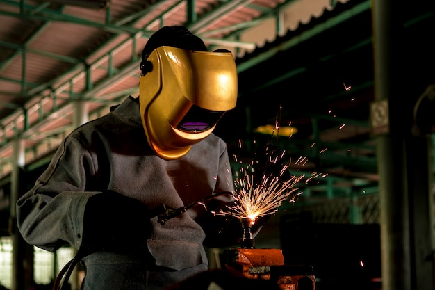 A craftman is welding with workpiece steel