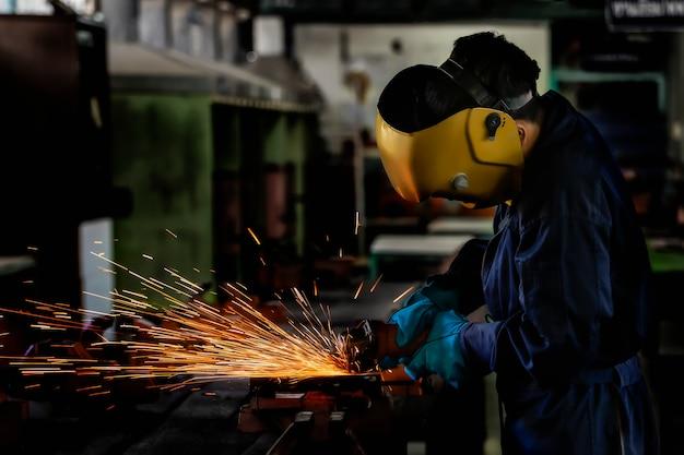 A craftman is welding with workpiece steel.