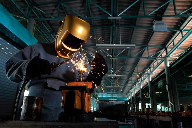 Craftman welding with workpiece steel