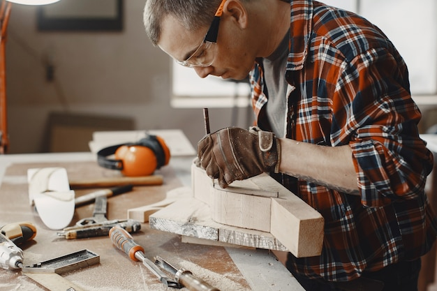 Craftsman creating wood piece
