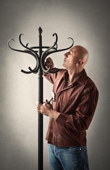 Craftsman with a handmade coat hanger