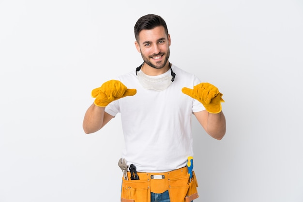 Craftsmen or electrician man over isolated white wall proud and self-satisfied