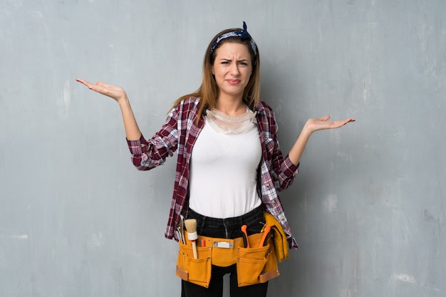 Craftsmen or electrician woman unhappy because not understand something