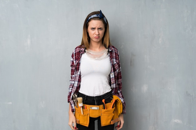 Craftsmen or electrician woman with sad and depressed expression