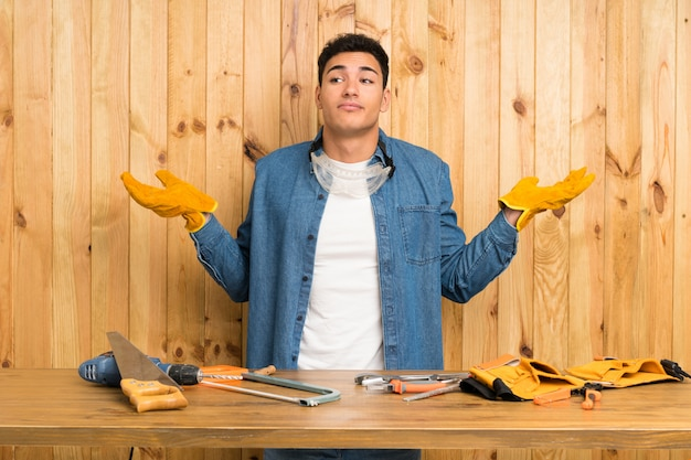 Craftsmen man over wood  having doubts with confuse face expression