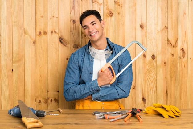 Craftsmen man over wood wall