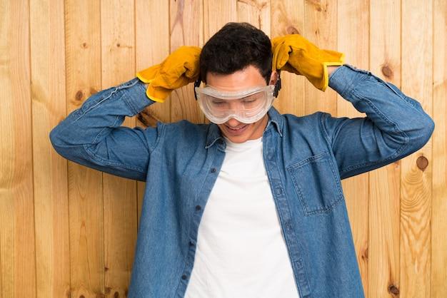 Craftsmen man over wood
