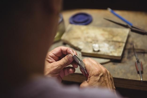 Craftswoman using pliers