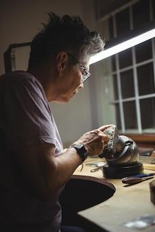 Craftswoman working in workshop