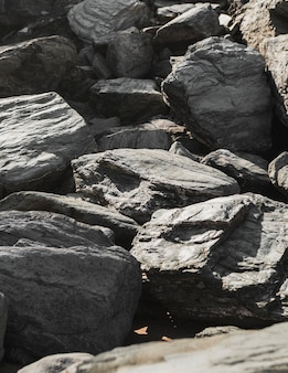 Craggy stones stacked together under the sun