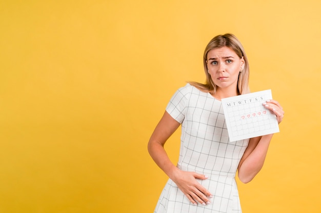 Cramps because menstruation and period calendar