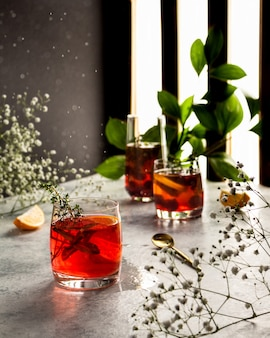Cranberry juice campari with mint and thyme splashes water drops