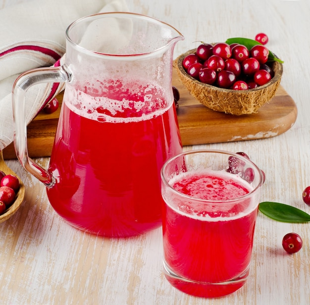 Cranberry juice and cranberry on wooden table