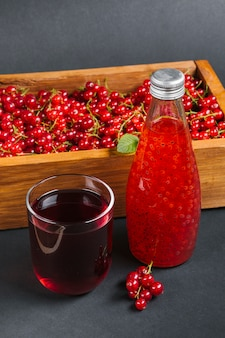 Cranberry juice and fruit on wooden box