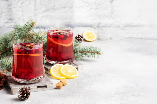 Cranberry juice with lemon and cane sugar. winter hot drink. copy space