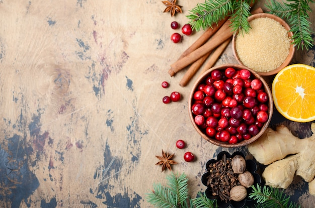Cranberry sauce ingredients on a wooden background. top view, flat lay, copyspace.