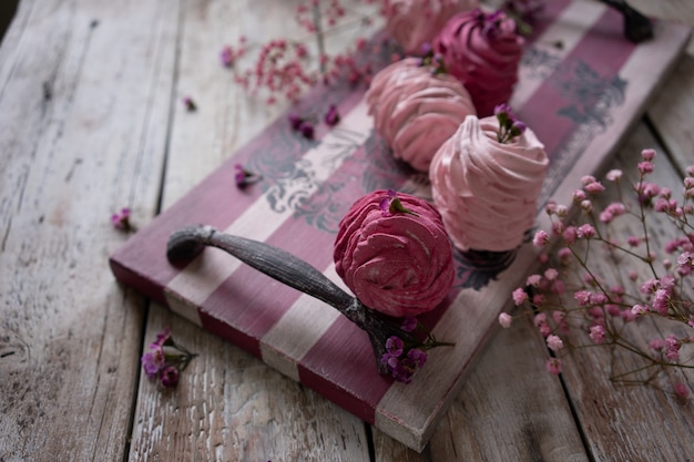 Cranberry and strawberry russian marshmallows on vintage wooden feed board