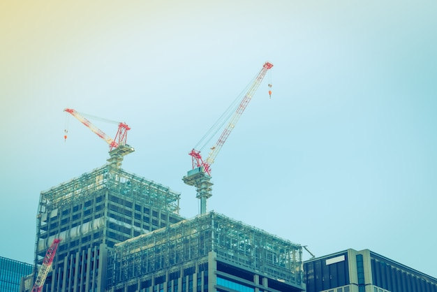 Crane and building construction site ( filtered image processed