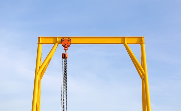 Crane for construction cradles against blue sky