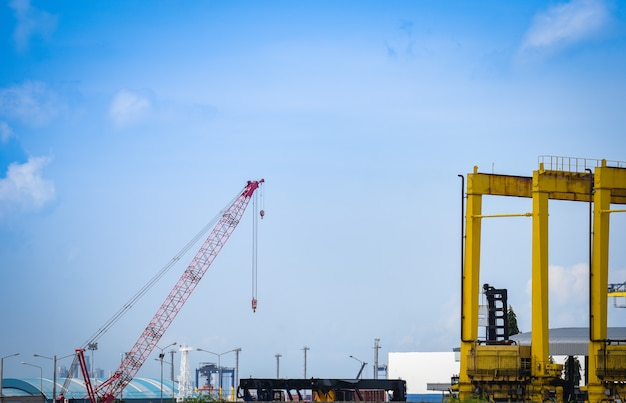 Crane and container ship in export and import business and logistics in harbor industry