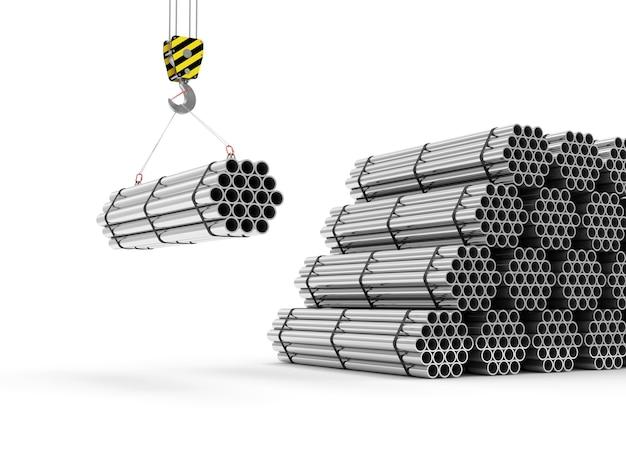 Крюк крана со стеком стальных металлических труб, изолированные на белом фоне