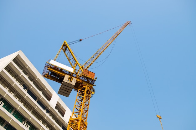 Crane yellow heavy industry working and building