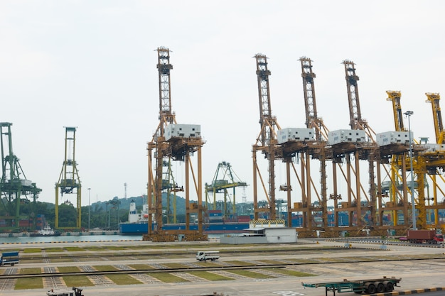 Cranes cargo shipping in singapore city.