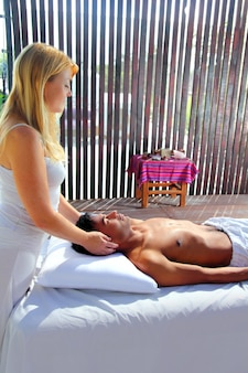 Cranial sacral massage theraphy in jungle cabin