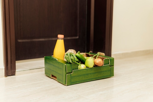 Crate of food with juice bottle
