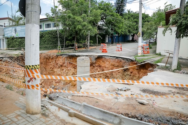 A crater has opened up in the street after heavy brazilian summer rains