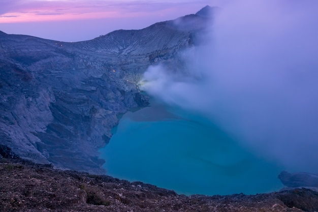 Crater of the sulfuric volcano ijen in bali before dawn