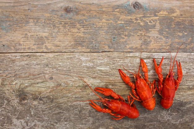 Crawfish on the old wooden background