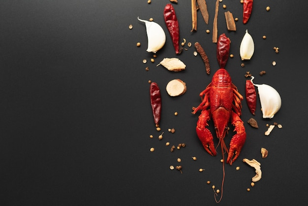 Crayfish red, baby lobster with herb for stir fry on black background