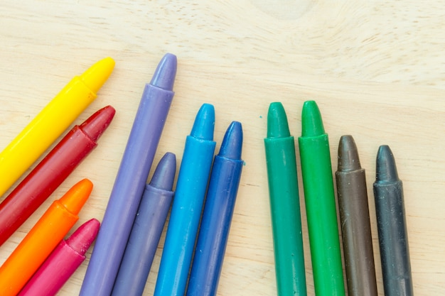 Crayon on wood background with copy space