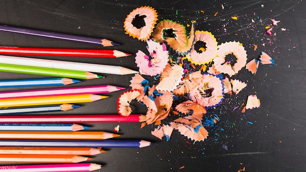 Crayons of bright colours with shavings