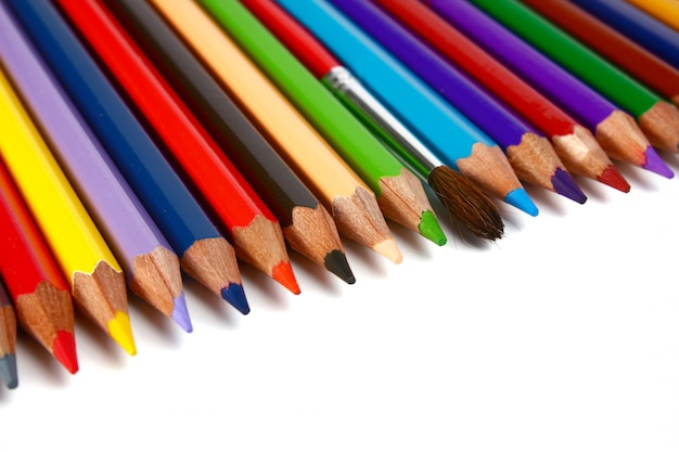 Crayons coloured pencils and brush for paints