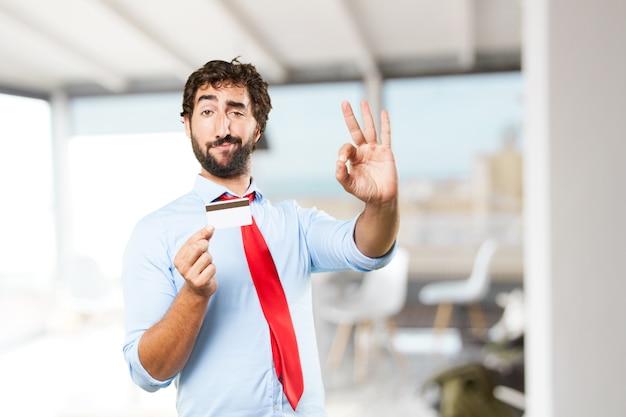 Сумасшедший бизнесмен счастливым выражением