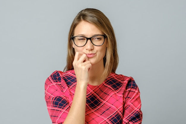 Crazy looking sly woman in glasses isolated