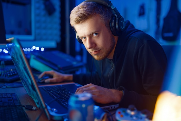 Crazy male gamer, gaming lifestyle, cyber addiction. computer games dependence, online videogame player in his room with neon light