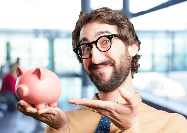 Crazy man with piggy bank.funny expression
