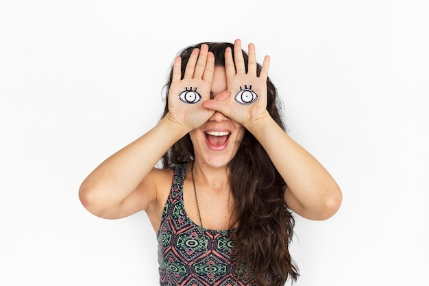 Crazy pretty girl with eyes in her hands