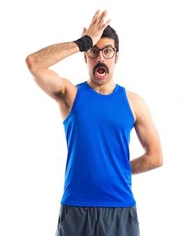 Crazy sportman doing surprise gesture