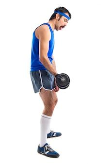 Crazy sportman doing weightlifting