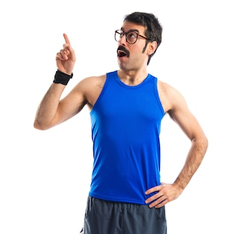 Crazy sportman thinking over white background