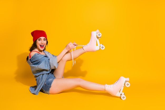 Crazy trend student girl sit floor tie shoe laces roller skates