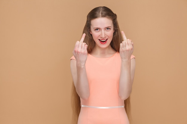 Crazy woman shows middle fingers and looking at camera