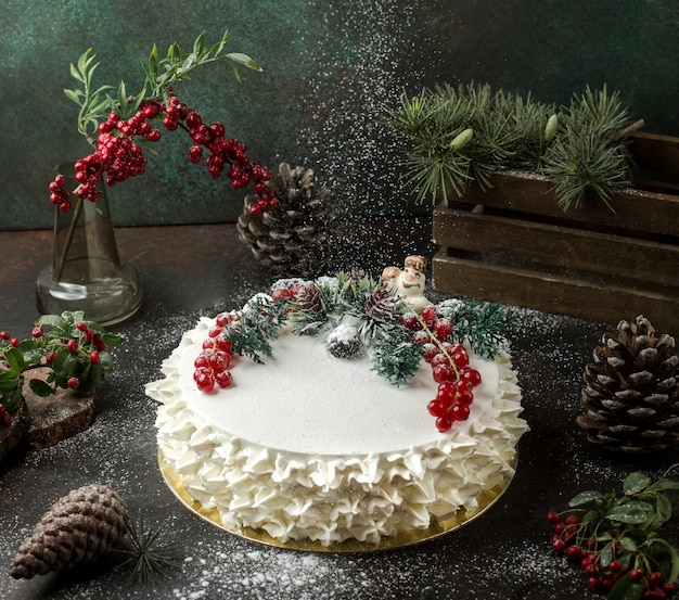 Cream cake with cranberries on the table